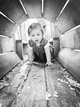 Emilia crawling through tunnel