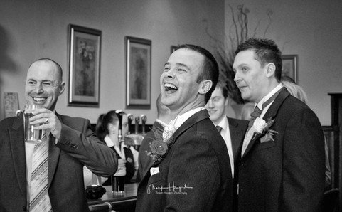 Groom enjoy a moment with his groomsmen