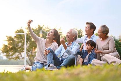 three generation happy asian family sitt