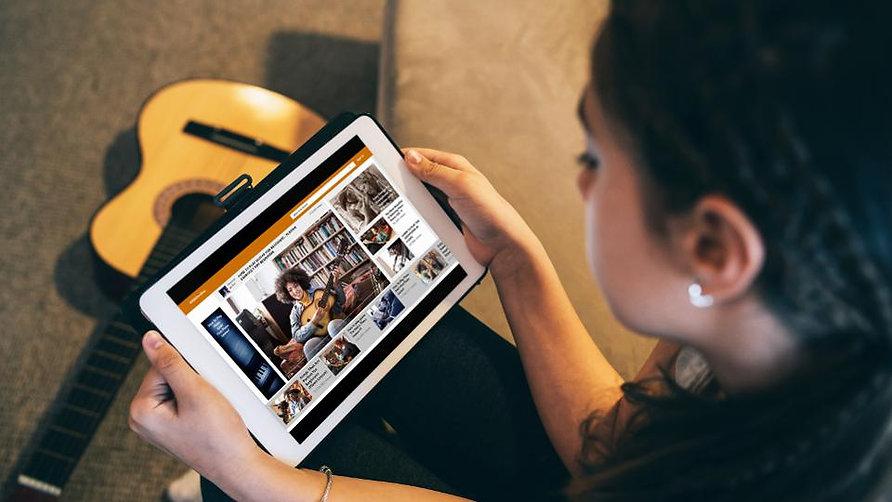 songwriter looking at tablet.jpg