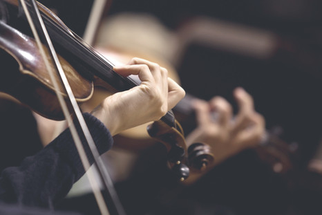 The girl's hand on the strings of a viol