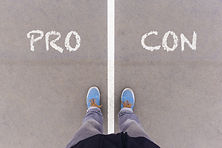 Pro and Con text on asphalt ground, feet