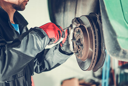 Car Brakes Servicing by Caucasian Vehicl