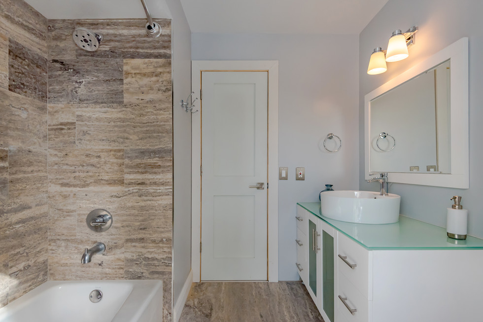 Custom Guest Bathroom Remodel with Shower Niche & All-Wood Vanity with Above Counter Basin