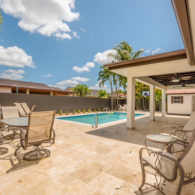Stunning Backyard Remodel Featuring Custom-Built Terrace, Immaculate Tile Work & Pool Area