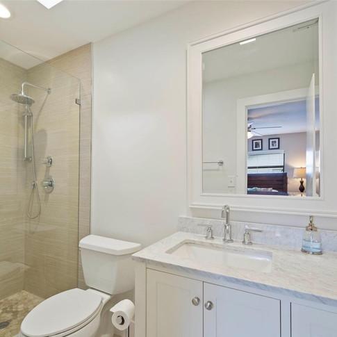 Simple & Elegant Master Bathroom Remodel Featuring Custom-Built Shower Niche & Frameless Shower Glass
