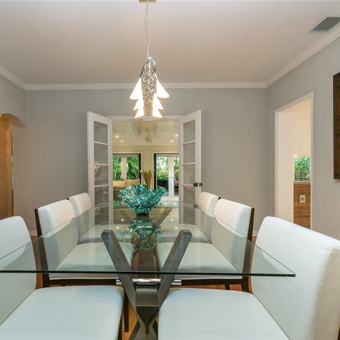 Elegantly-Designed Dining Room Accentuated by Wood Floors & Soft Lighting 3
