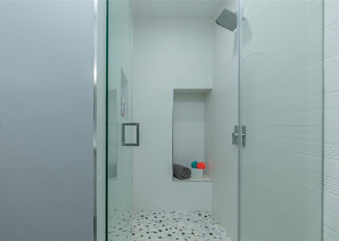 Contemporary Guest Bathroom Remodel Featuring Custom-Built Shower Niche & All-White Design