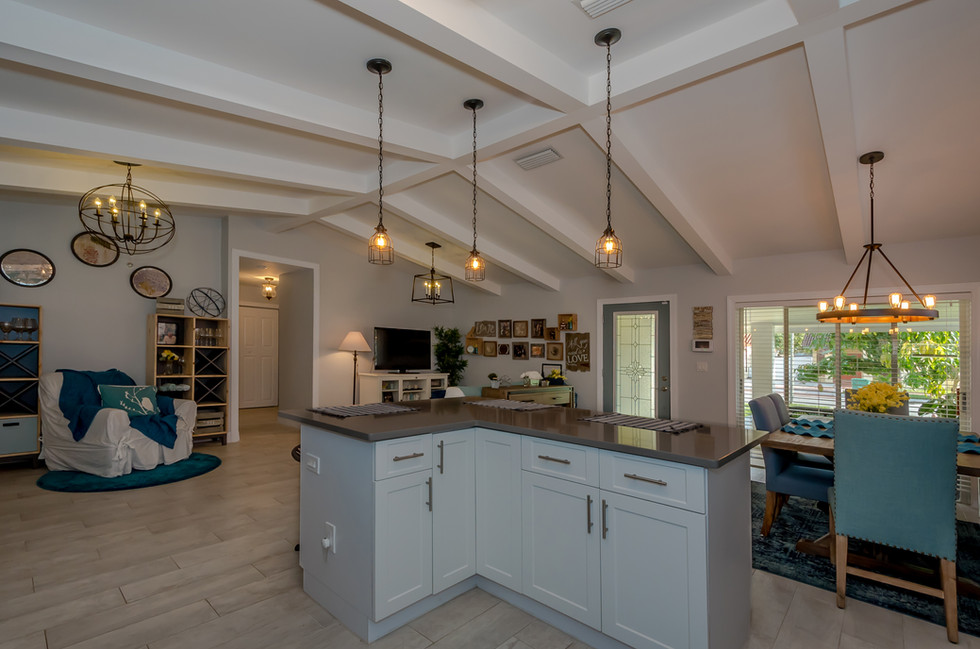 Breathtaking Southwestern Interior Design Remodel Featuring Custom-Built White Kitchen Cabinets Contrasted by Gray Quartz, Subway Tiles & Decorative Wood Trusses 4