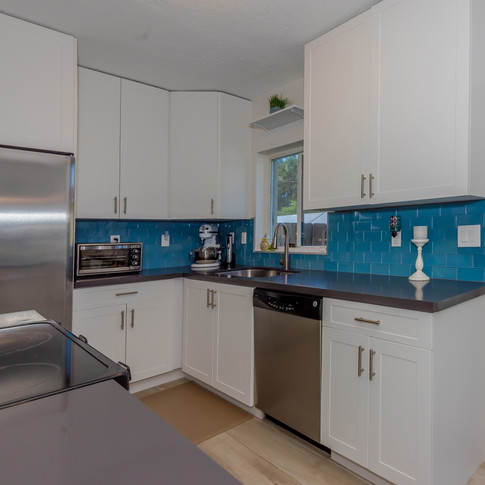 Transitional White Kitchen Remodel with Sharp Blue Glass Subway Backsplash Tiles