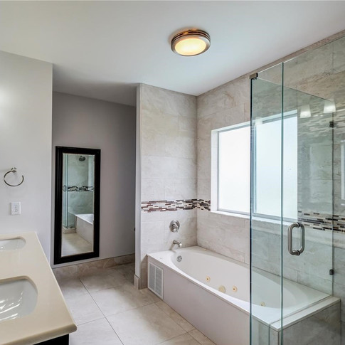 Custom-Built Master Bathroom Remodel Featuring a Walk-in Shower, Tub & Accent Tiling Throughout