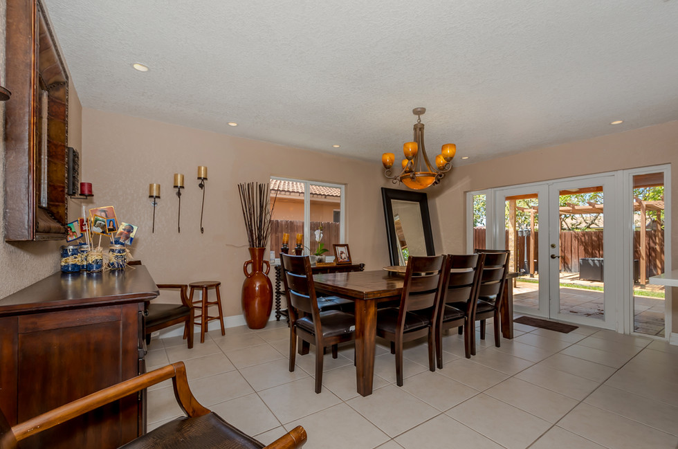 Elegantly Decorated Dining Room Area Adjacent To Newly Remodeled Kitchen Area