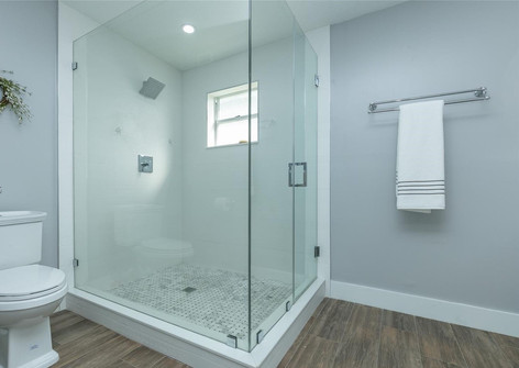 Contemporary Master Bathroom Remodel Featuring Walk-in Shower, Wood-Plank Floor Tiles & Frameless Shower Glass Doors