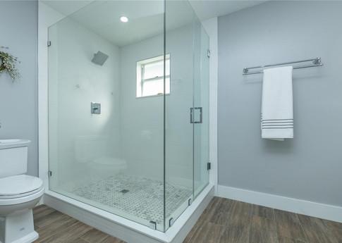 Contemporary Master Bathroom Remodel Featuring Walk-in Shower, Wood-Plank Floor Tiles & Frameless Shower Glass Doors