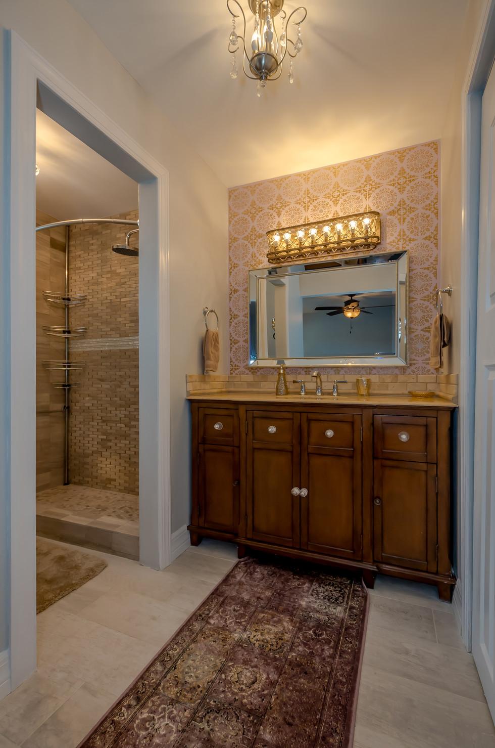 Lovely Master Bathroom Vanity Remodel Highlighted by Unique Wallpaper & Elegant Lighting