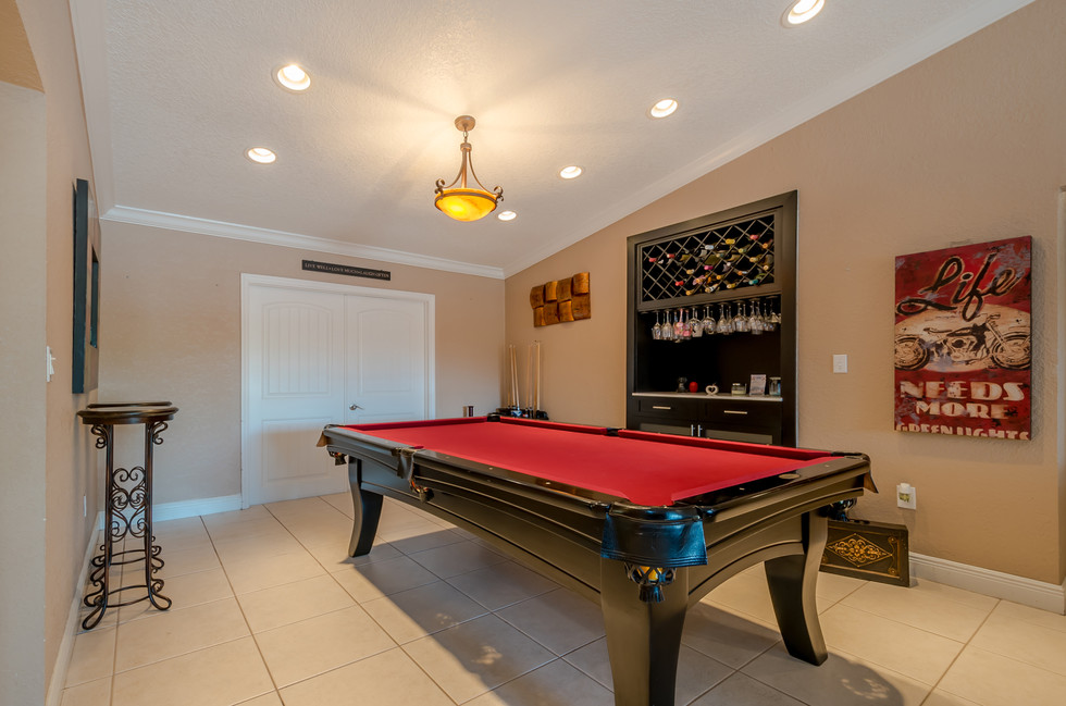 Game Room Featuring Vaulted Ceiling, Recessed LED Lighting & Custom Built-In Bar Area