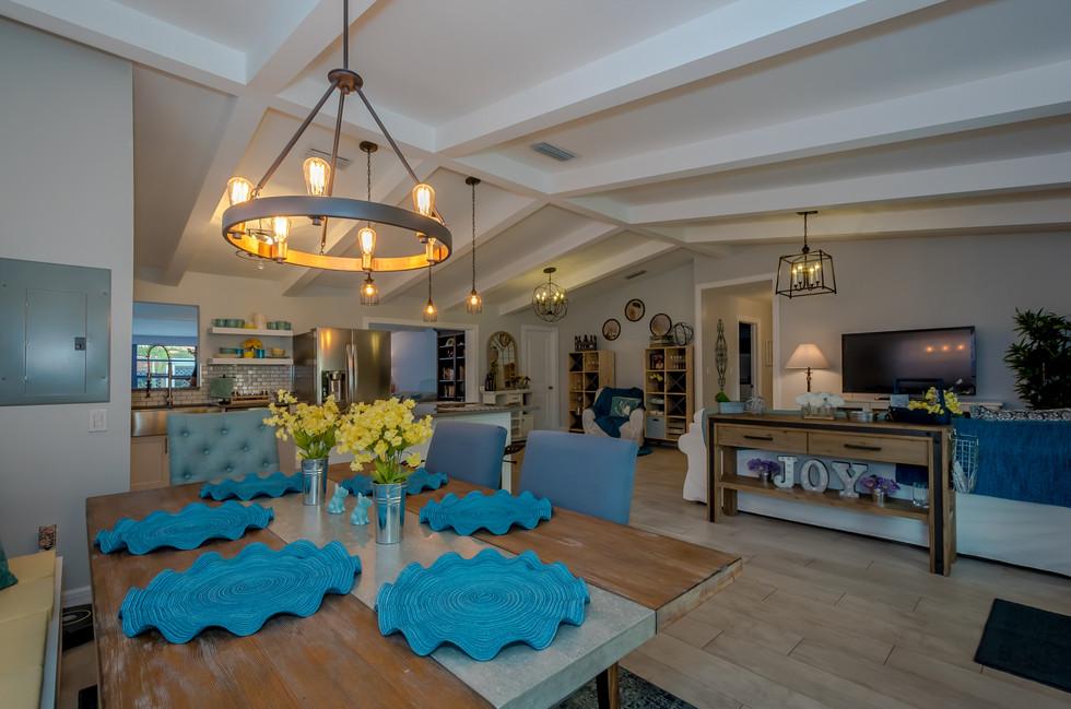 Breathtaking Southwestern Interior Design Featuring Wood Plank Tiles, Custom Kitchen Remodel & Decorative Wood Trusses