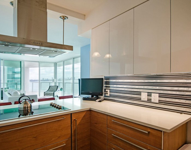 Modern Kitchen Design with Unique Two-Tone Cabinets & Range Hood
