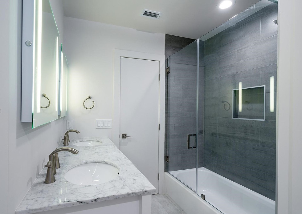 Modern-Design Guest Bathroom Remodel Featuring Double Vanity, LED Mirrors, Shower Niche & Custom Glass Shower Doors