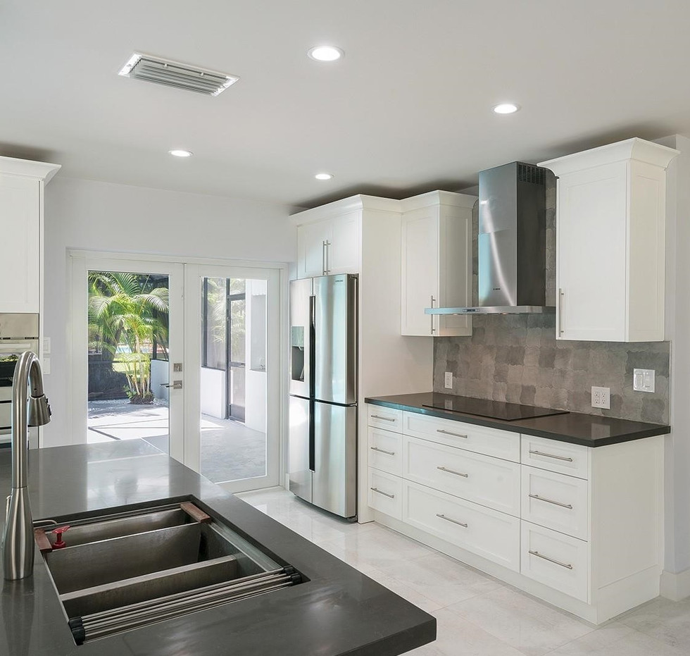 Custom, Gray & White Contemporary Kitchen Remodel Highlighted By a Range Hood, Double Oven & Kitchen Island