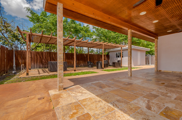 Custom-Built Backyard Terrace & Pergola Accentuated by Recessed Lighitng & Immaculate Tile Work