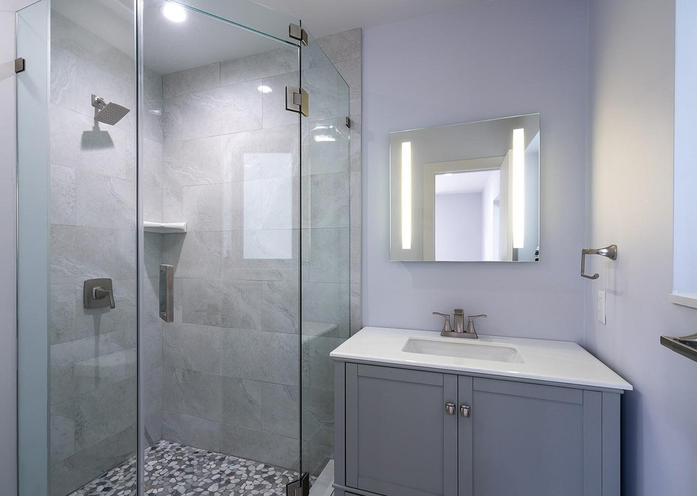 Modern-Design Guest Bathroom Remodel Featuring a Gray Vanity, LED Mirrors & Custom Glass Shower Doors