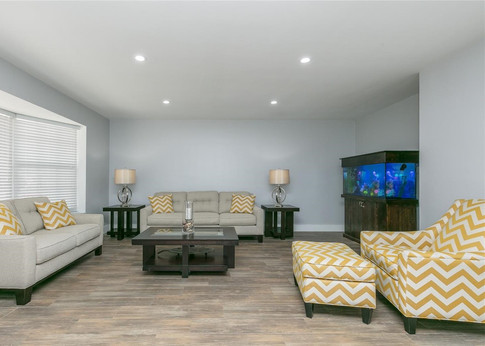 Contemporary Living Room Interior Design Featuring Recessed Lighitng & Wood Plank Floor Tiles