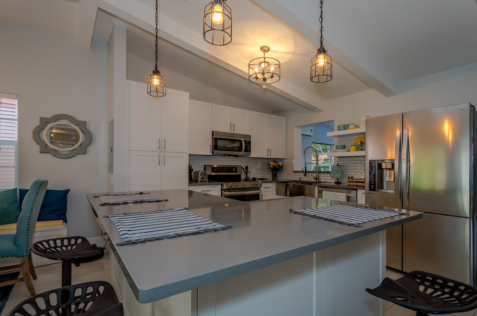 Breathtaking Southwestern Interior Design Remodel Featuring Custom-Built White Kitchen Cabinets Contrasted by Gray Quartz, Subway Tiles & Decorative Wood Trusses 2