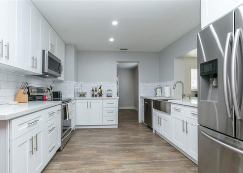 Contemporary All-White Kitchen Remodel Featuring Custom Cabinetry, Quartz & Subway Backsplash Tiles