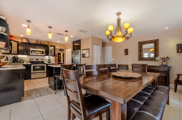 Custom-Built, All-Wood Kitchen Remodel With Black-Stained Cabinets, Solid White Quartz, Kitchen Island & Open Layout Floor Plan