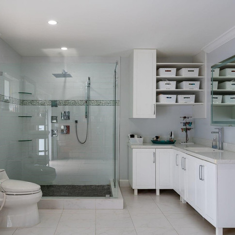 Contemporary, Open-Concept, All-White Master Bathroom Remodel Featuring a Walk-In Shower, Wrap-Around Vanity & Custom Wall Cabinetry
