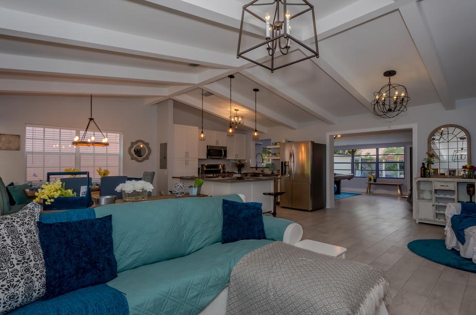 Breathtaking Southwestern Interior Design Featuring Wood Plank Tiles, Elegant Lighting & Decorative Wood Trusses 5