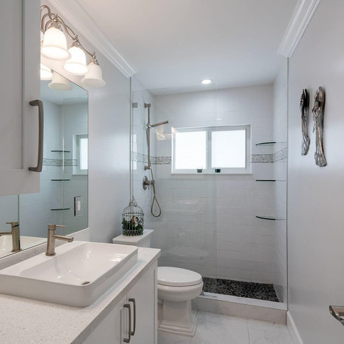 Contemporary, All-White Guest Bathroom Remodel with Custom, Frameless Shower Glass Doors