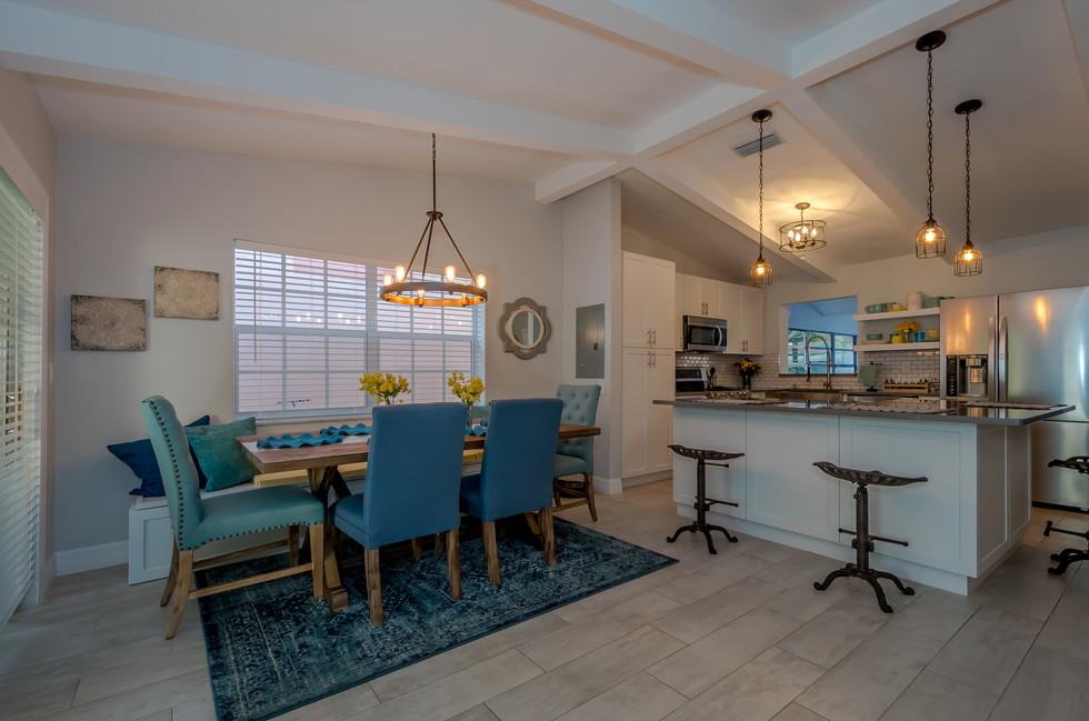 Breathtaking Southwestern Interior Design Featuring Wood Plank Tiles, Custom Kitchen Remodel & Decorative Wood Trusses 3