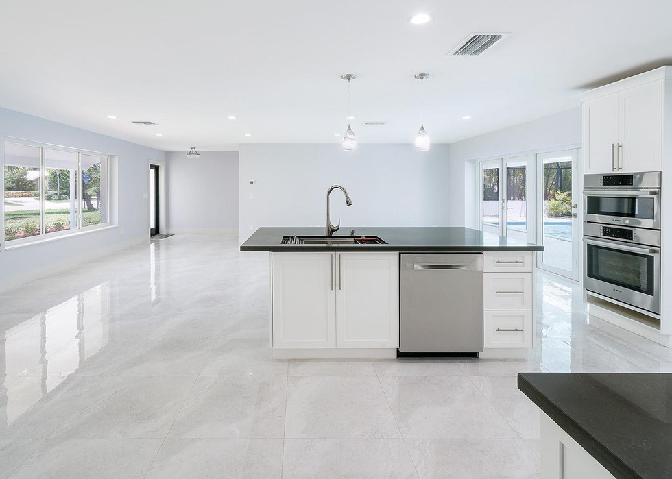 Open-Layout, Gray & White Contemporary Kitchen Remodel Highlighted By a Range Hood, Double Oven & Kitchen Island 2