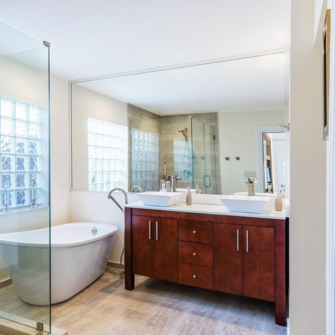Transitional Master Bathroom Remodel Featuring Free Standing Tub, Cherry-Finish Double Vanity With Above Counter Basins & Walk-In Shower