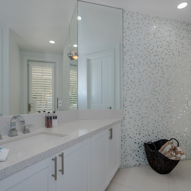 Elegant Cabana Bathroom Remodel Featuring Accent Wall of Marble Mosiac Tile & Matching Quartz