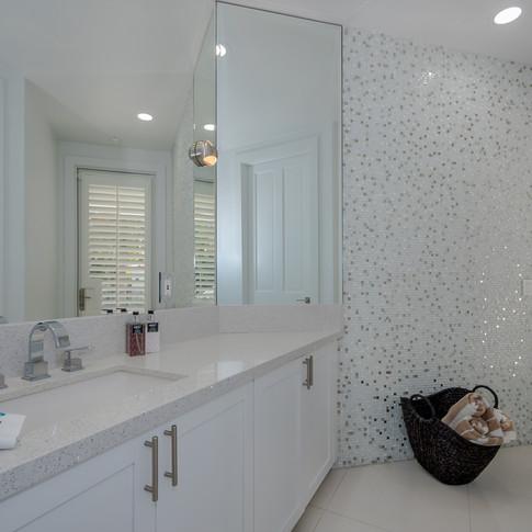 Elegant Cabana Bathroom Remodel Featuring Accent Wall of Marble Mosiac Tile & Matching Quartz