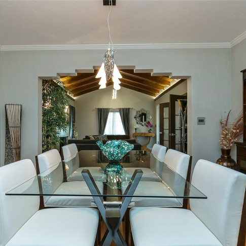 Elegantly-Designed Dining Room Accentuated by Wood Floors & Soft Lighting 2