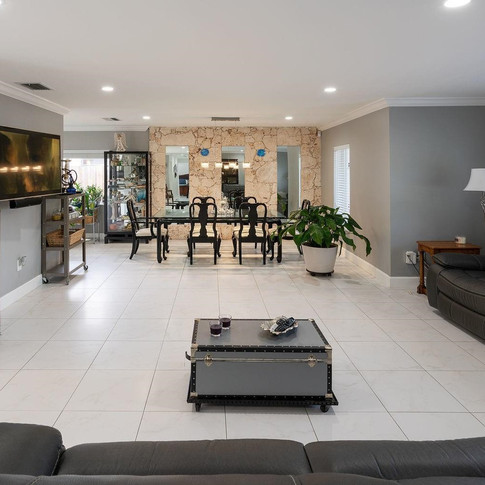 Open-Layout Living Room Remodel with Accent Rock Wall
