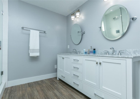 Contemporary Master Bathroom Remodel Featuring Double Vanity, Wood-Plank Floor Tiles & Soft Paint Color