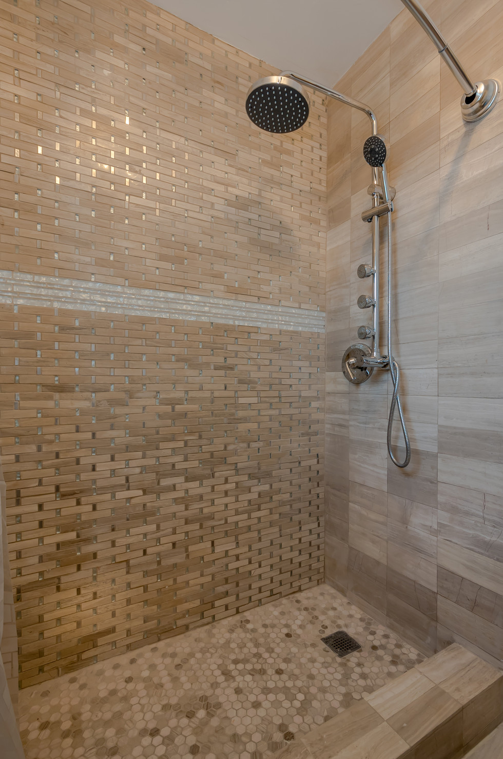 Custom Master Bathroom Shower Remodel Featuring Immaculate Tile Work & Shower Bar