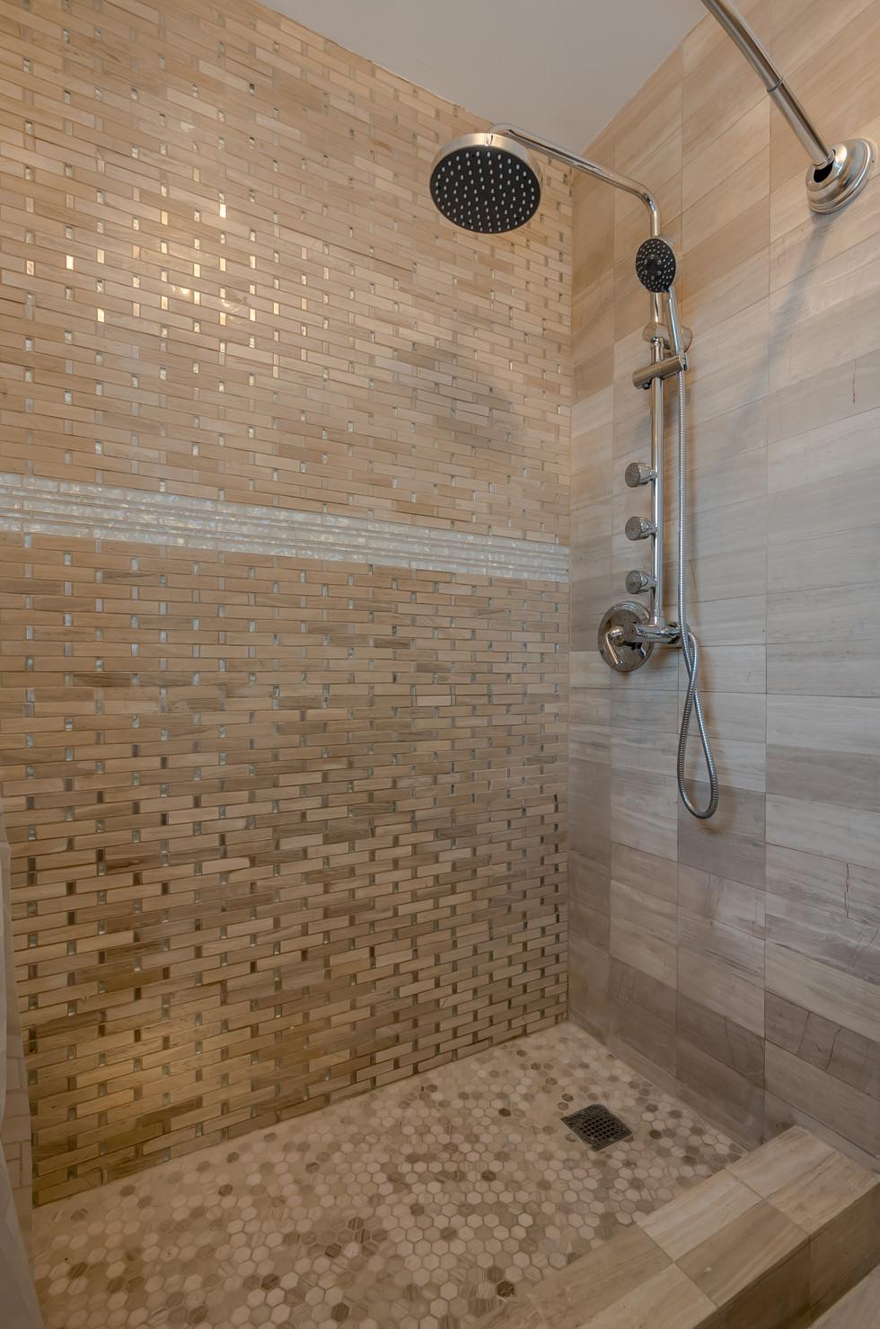 Custom Master Bathroom Shower Remodel Featuring Immaculate Tile Work & Shower Bar