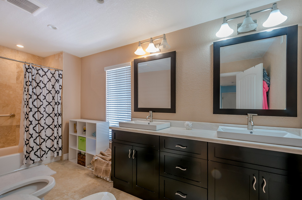 Master Bathroom Remodel Featuring Custom-Built Double Vanity with Above-Counter Basins