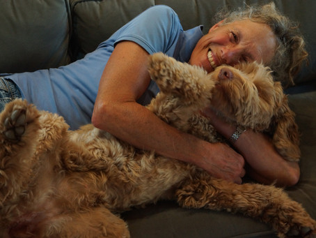 Emily and Quill, Australian Labradoodle cuddling