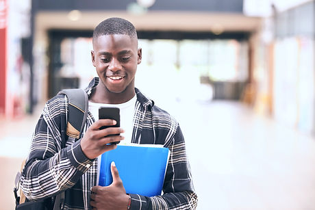 Male College Student Reading Text Message On Mobile Phone_edited_edited_edited.jpg