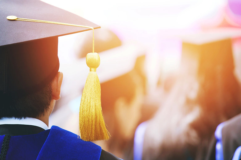 shot of graduation hats during commencem