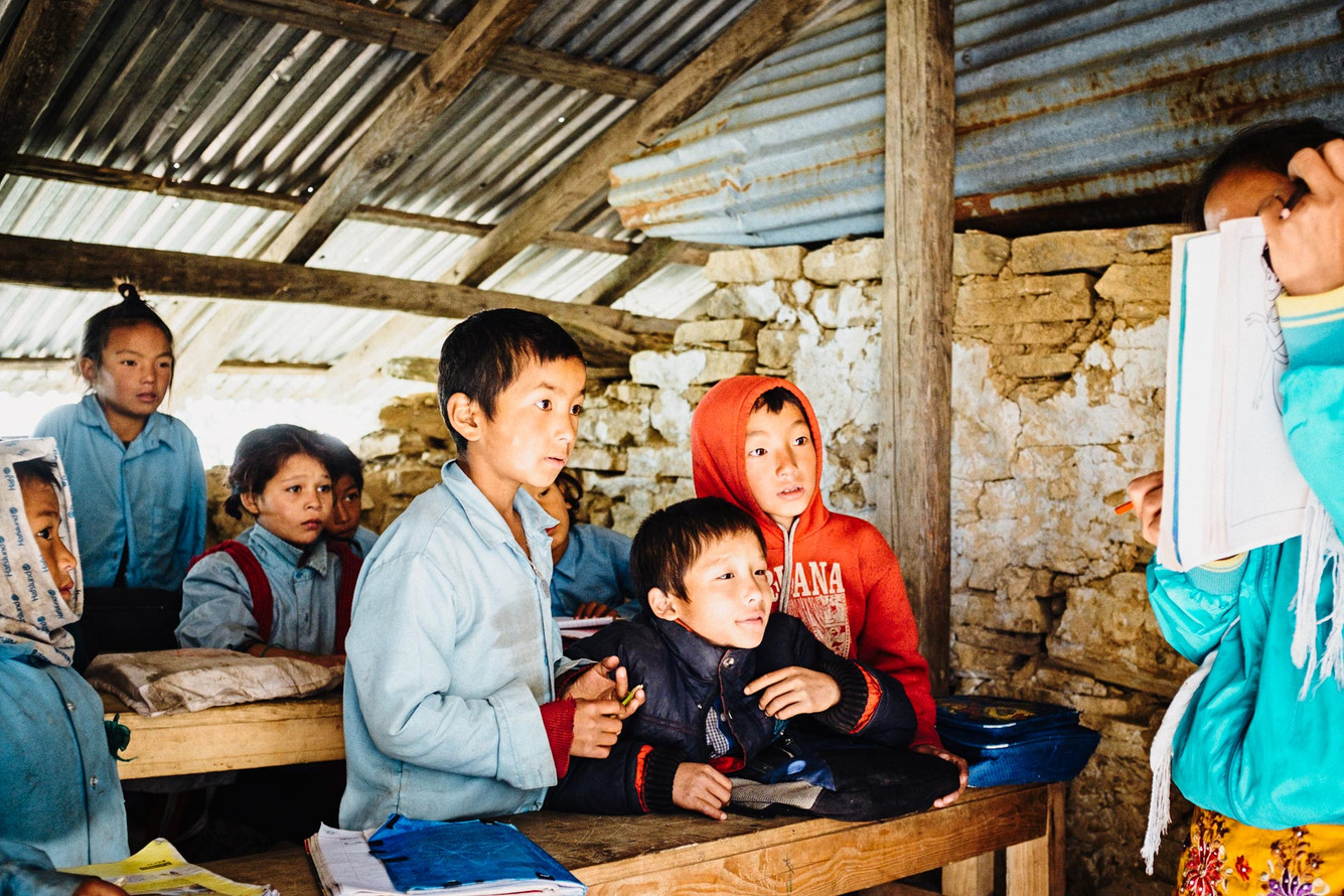 School class in upper Tipling. The school has 12 teachers and 256 students. Retaining teachers in Tipling is difficult, as the majority comes from Dhading Besi or Kathmandu, several days away. As a result, teachers are often absent.