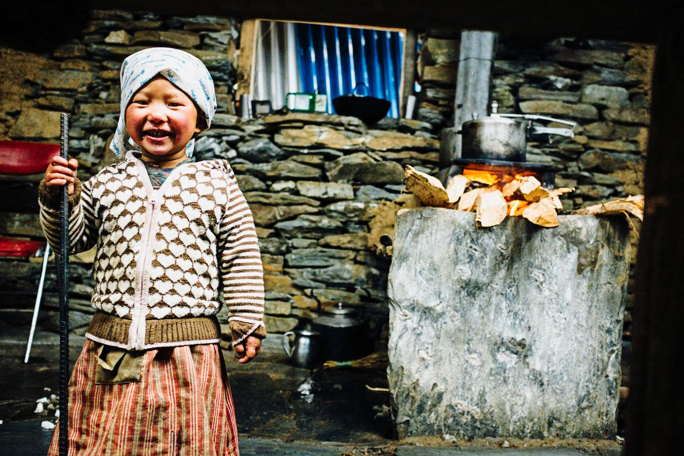 Young girl in Pangsang Pass. At 3840m, the pass is the fastest way to transport goods to Tipling.