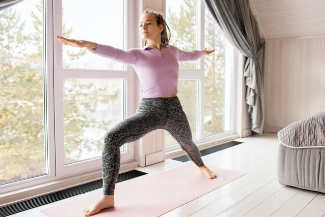 A lady exercising at home